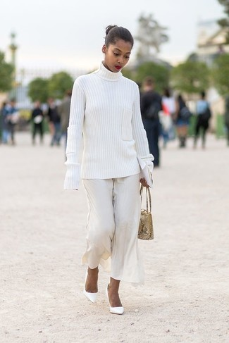 How to wear: white knit turtleneck, white wide leg pants, white leather pumps, beige snake leather handbag