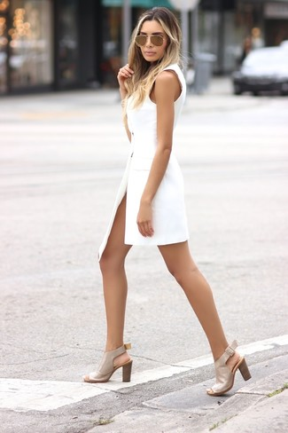 How to wear: white tuxedo dress, beige leather heeled sandals, gold sunglasses