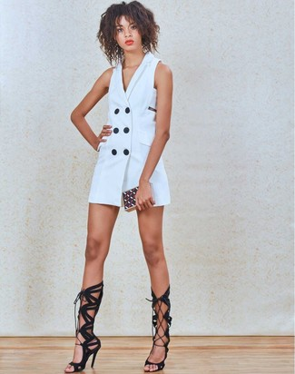 You can be sure you'll look dazzling in a tuxedo dress. A pair of black suede knee high gladiator sandals ads edginess to a femme classic. Great for hot weather, this combination will gain quite a few likes on the 'gram too.