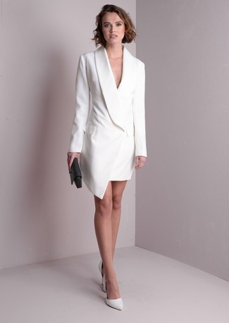 Without any doubt, you'll look outrageously gorgeous in a tuxedo dress. White leather pumps will contrast beautifully against the rest of the look. Loving this one, especially for springtime.