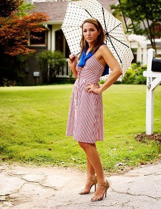 Dress in a white vertical striped casual dress for an easy to wear look. Play down the casualness of your look with pumps. This combination is everything for roasting hot warm weather days.