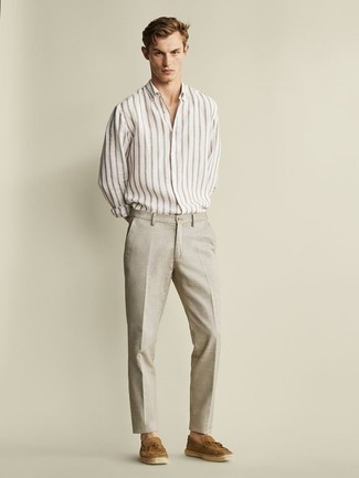 Men's Looks & Outfits: What To Wear In 2020: Pairing a white vertical striped long sleeve shirt and beige linen dress pants is a guaranteed way to infuse personality into your styling arsenal. Complete this outfit with a pair of tan suede tassel loafers to easily bump up the style factor of any ensemble.