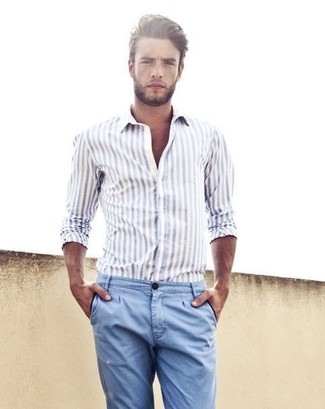 Consider wearing a white striped long sleeve shirt and blue casual trousers for a trendy and easy going look. This combination is essentially a lesson in how to master the warm weather fashion.