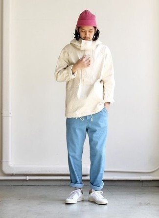 White Windbreaker Casual Outfits For Men: You'll be amazed at how easy it is for any gentleman to get dressed like this. Just a white windbreaker and light blue jeans. All you need now is a pair of white leather low top sneakers to finish this outfit.