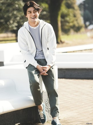 White Windbreaker Outfits For Men: When you want to go about your day with confidence in your look, opt for a white windbreaker and olive chinos. Complete your outfit with dark green low top sneakers for extra style points.