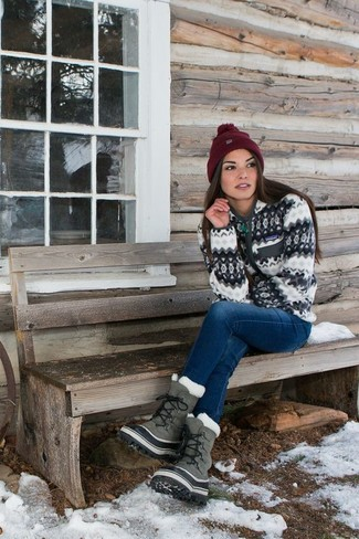 How to wear: white zip sweater, blue jeans, grey snow boots, burgundy beanie