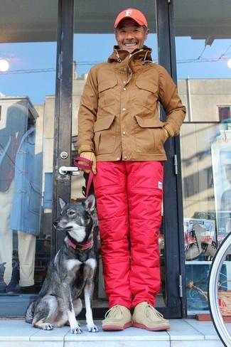 How to wear: brown windbreaker, pink cargo pants, beige suede desert boots, orange baseball cap