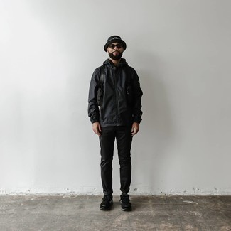 Black Windbreaker Outfits For Men: Make a black windbreaker and black chinos your outfit choice for both seriously stylish and easy-to-style getup. For something more on the relaxed end to round off this ensemble, complete this look with a pair of black and white athletic shoes.