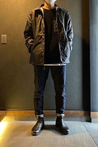 Black Crew-neck Sweater Outfits For Men: A black crew-neck sweater and navy jeans are the kind of a winning off-duty combination that you so terribly need when you have no time to pull together an outfit. Here's how to smarten up this outfit: black leather chelsea boots.