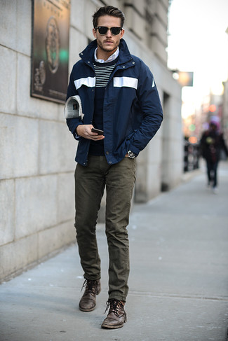 Consider teaming a windbreaker with olive skinny jeans to bring out the stylish in you. A pair of dark brown leather casual boots adds more polish to your overall look.  An ensemble like this makes it easy to embrace unpredictable transeasonal weather.