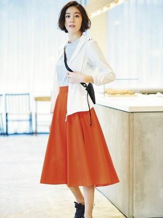 How to Wear a Red Pleated Midi Skirt: A white windbreaker and a red pleated midi skirt are a savvy combo that will effortlessly carry you throughout the day. Rounding off with a pair of black athletic shoes is the simplest way to introduce a more casual feel to your ensemble.