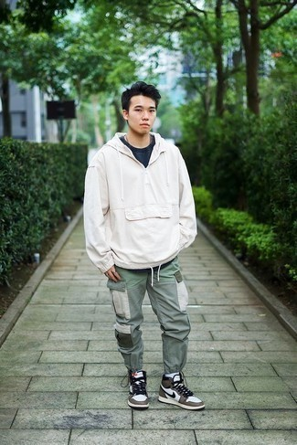 White and Brown High Top Sneakers Outfits For Men: Who said you can't make a fashion statement with a casual look? You can do so with ease in a white windbreaker and mint cargo pants. A pair of white and brown high top sneakers immediately kicks up the appeal of your look.