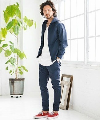How to Wear Black No Show Socks For Men: A navy windbreaker and black no show socks are essential menswear items, without which no casual wardrobe would be complete. Why not take a classic approach with footwear and complement your outfit with a pair of red canvas low top sneakers?