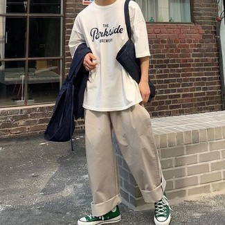 Beige Chinos Outfits: One of the most popular ways for a man to style out a navy windbreaker is to team it with beige chinos in a laid-back outfit. Does this getup feel all-too-perfect? Enter a pair of dark green canvas high top sneakers to mix things up.