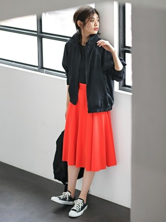 How to wear: black windbreaker, black crew-neck t-shirt, red pleated midi skirt, black and white canvas low top sneakers