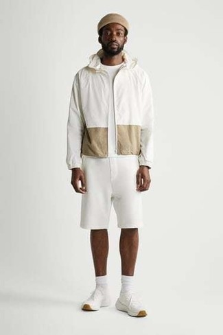 White Sports Shorts Outfits For Men: This casual pairing of a white windbreaker and white sports shorts is very versatile and really apt for whatever adventure you may find yourself on. Complement this look with white athletic shoes et voila, the look is complete.