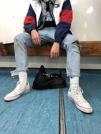 Light Blue Ripped Jeans Outfits For Men: Team a white and red and navy windbreaker with light blue ripped jeans for a look that's both relaxed casual and on-trend. The whole ensemble comes together when you add white canvas high top sneakers to your ensemble.
