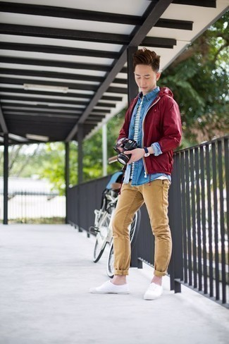 Teen Boy Fashion: What To Wear: Pairing a burgundy windbreaker with khaki chinos is an on-point pick for a relaxed look. White canvas low top sneakers pull the outfit together. Casual adolescent style done right.