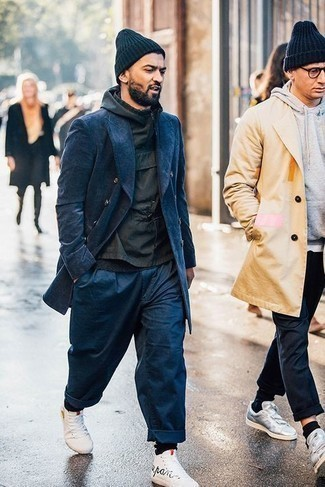 Black Windbreaker Outfits For Men: A black windbreaker and navy chinos combined together are a match made in heaven for guys who love laid-back combos. Does this outfit feel all-too-fancy? Let a pair of white and black print canvas high top sneakers change things up a bit.