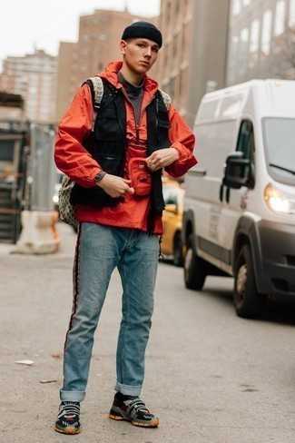 How to Wear an Olive Canvas Backpack For Men: Rock a red windbreaker with an olive canvas backpack, if you want to dress for comfort without looking like a slob to look stylish. If you're on the fence about how to finish, a pair of navy athletic shoes is a surefire option.