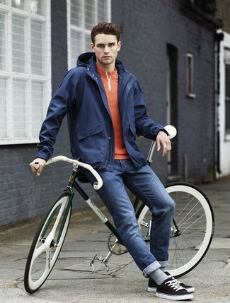 How to wear: navy windbreaker, orange henley shirt, navy skinny jeans, black low top sneakers