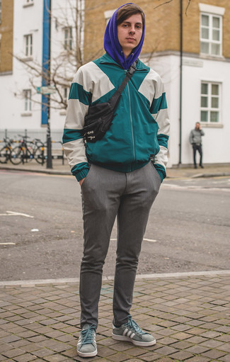 How to Wear a Black Canvas Fanny Pack Casually For Men: Choose a teal windbreaker and a black canvas fanny pack if you want to look cool and casual without spending too much time. Feel somewhat uninspired with this ensemble? Introduce mint canvas low top sneakers to mix things up.