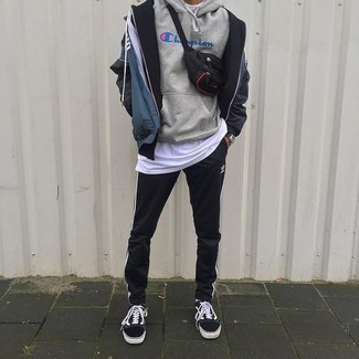 How to wear: navy print windbreaker, grey print hoodie, white crew-neck t-shirt, black and white vertical striped sweatpants