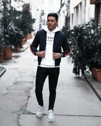 Black Jeans Spring Outfits For Men In Their 20s: Try pairing a navy windbreaker with black jeans for both stylish and easy-to-wear ensemble. Complete your getup with a pair of white athletic shoes to make an all-too-safe ensemble feel suddenly fun and fresh. As the weather gets warmer, it's time to  get rid of those heavy winter gear and choose something lighter, like this ensemble here. After all, when do you wear casual combinations like this if not at 20?