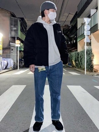 Grey Hoodie Outfits For Men: Pairing a grey hoodie with blue jeans is an on-point choice for a cool and casual look. Avoid looking too casual by rounding off with a pair of black suede desert boots.