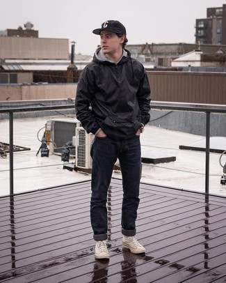 Beige Canvas High Top Sneakers Outfits For Men: Extremely dapper and practical, this casual pairing of a black windbreaker and black jeans provides with amazing styling possibilities. For something more on the daring side to finish this ensemble, add beige canvas high top sneakers.