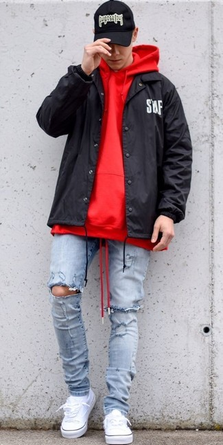 How to wear: black windbreaker, red hoodie, light blue ripped skinny jeans, white canvas low top sneakers