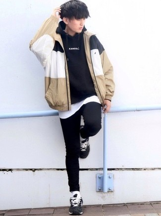 White Tank Outfits For Men: Why not marry a white tank with black skinny jeans? As well as very comfortable, these two items look awesome worn together. Black and white athletic shoes are a tested footwear style that's full of personality.