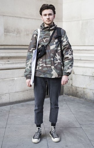 Charcoal Jeans Outfits For Men: An olive camouflage windbreaker and charcoal jeans? This is easily a wearable ensemble that you can sport on a day-to-day basis. Opt for a pair of black and white canvas high top sneakers to add a sense of stylish effortlessness to your outfit.