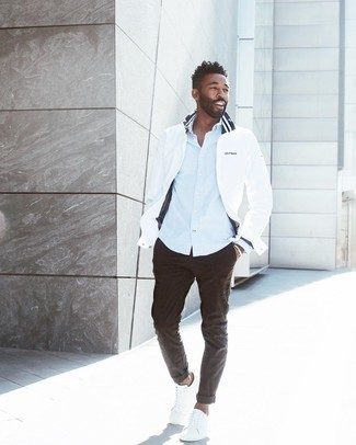 White Windbreaker Outfits For Men: A white windbreaker and dark brown chinos are amazing menswear essentials that will integrate well within your day-to-day casual repertoire. Introduce white canvas low top sneakers to the mix and you're all set looking spectacular.