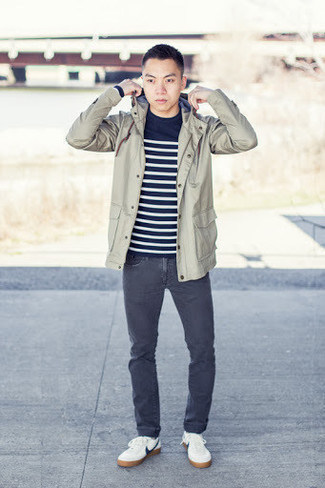 Charcoal Jeans Outfits For Men: You'll be surprised at how extremely easy it is for any guy to put together this relaxed casual outfit. Just a beige windbreaker teamed with charcoal jeans. If not sure as to what to wear when it comes to shoes, go with white and navy leather low top sneakers.
