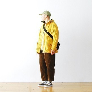 Brown Chinos Outfits: A mustard windbreaker and brown chinos? This is easily a wearable outfit that any gent could rock a version of on a day-to-day basis. Olive canvas low top sneakers complete this outfit very well.