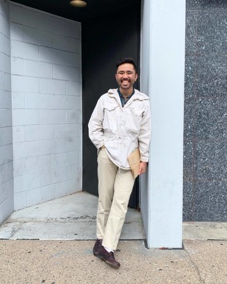 White Windbreaker Outfits For Men: Here, the cool-kid casual style translates to a white windbreaker and beige jeans. Tone down the casualness of this look by sporting burgundy leather loafers.