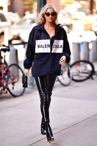 How to wear: navy print windbreaker, black leather skinny pants, black leather ankle boots, black leather clutch