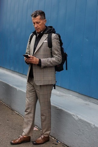 Grey Plaid Suit Outfits: This pairing of a grey plaid suit and a black windbreaker will add casually sleek essence to your ensemble. Finishing off with a pair of brown leather monks is a guaranteed way to introduce some extra fanciness to this getup.