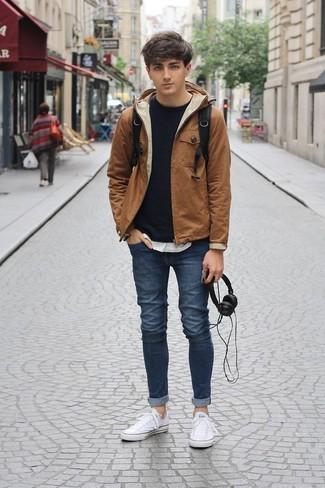 How to wear: tobacco windbreaker, black sweatshirt, white crew-neck t-shirt, navy skinny jeans