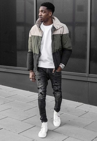 How to Wear White Canvas High Top Sneakers For Men: Consider pairing a multi colored windbreaker with charcoal ripped jeans for a casual ensemble with a street style take. Let your sartorial sensibilities truly shine by rounding off your ensemble with white canvas high top sneakers.