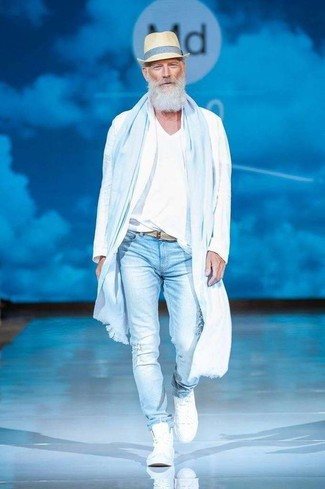 How to wear: white windbreaker, white v-neck t-shirt, light blue ripped skinny jeans, white high top sneakers