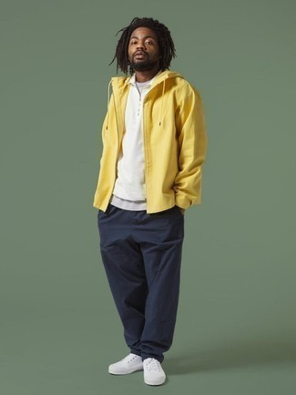 How to Wear a Yellow Windbreaker For Men: Pairing a yellow windbreaker with navy chinos is a savvy pick for a casual getup. Complete your outfit with a pair of white canvas low top sneakers and you're all done and looking killer.