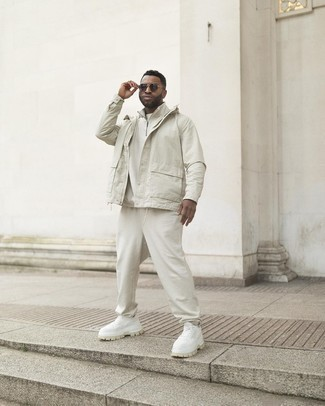 White Windbreaker Outfits For Men: Extremely dapper, this combo of a white windbreaker and white sweatpants provides excellent styling possibilities. And if you want to immediately dress down this look with one single piece, complete your look with a pair of white athletic shoes.