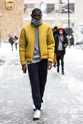 How to Wear a Grey Knit Turtleneck For Men: If you like stay-in clothes which are stylish enough to wear out, make a grey knit turtleneck and black and white sweatpants your outfit choice. For something more on the elegant end to finish off this look, add white low top sneakers to the equation.