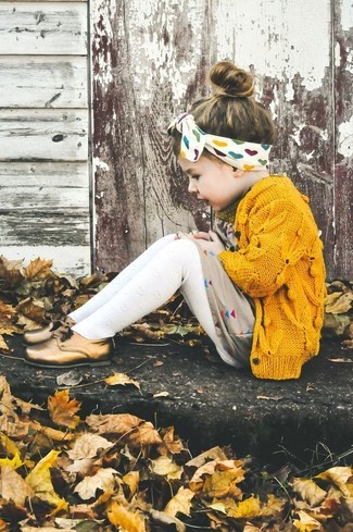 How to wear: yellow cardigan, beige dress, gold oxford shoes, white tights