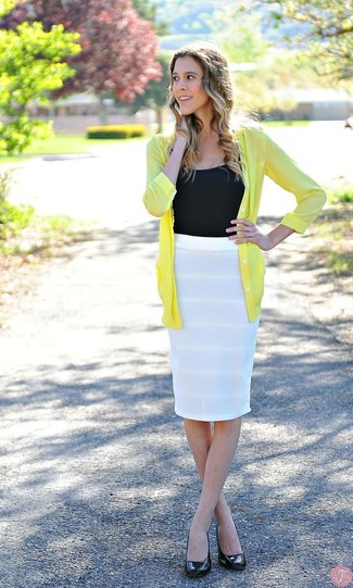 Pair a yellow cardigan with a white pencil skirt to feel confidently and look fashionably. A pair of black leather pumps will seamlessly integrate within a variety of outfits.