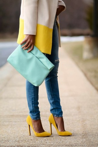 If you feel more confident in comfy clothes, you'll love this absolutely chic pairing of a yellow coat and bottom. This ensemble is complemented perfectly with yellow suede pumps. We guarantee this outfit is the answer to all of your spring style struggles.