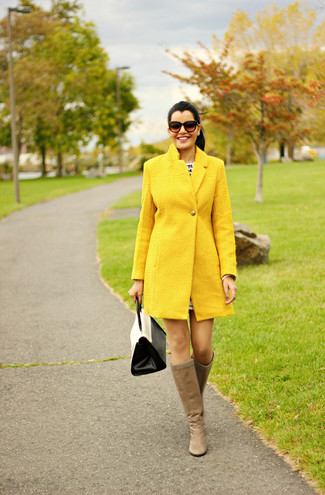 How to wear: yellow coat, tan leather knee high boots, white and black leather satchel bag