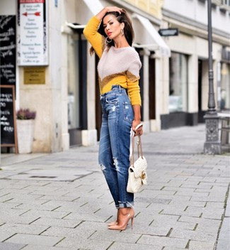 How to Wear Tan Leather Pumps: Teaming a yellow chevron crew-neck sweater with blue ripped boyfriend jeans is a good choice for a laid-back getup. And if you wish to immediately rev up this outfit with one single piece, add a pair of tan leather pumps to this outfit.